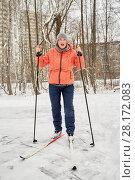 Купить «Woman in orange jacket on skis in winter park», фото № 28172083, снято 19 января 2016 г. (c) Losevsky Pavel / Фотобанк Лори