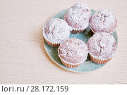 Купить «Closeup five cupcakes on plate on table», фото № 28172159, снято 19 января 2016 г. (c) Losevsky Pavel / Фотобанк Лори