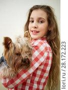 Купить «Portrait of girl with yorkshire terrier on arms», фото № 28172223, снято 19 января 2016 г. (c) Losevsky Pavel / Фотобанк Лори
