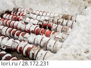 Купить «Bunker with rotating rolls for processing snow from city streets», фото № 28172231, снято 20 января 2016 г. (c) Losevsky Pavel / Фотобанк Лори