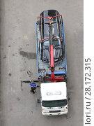 Купить «Crashed black car is standing on tow truck platform at the highway», фото № 28172315, снято 9 сентября 2015 г. (c) Losevsky Pavel / Фотобанк Лори