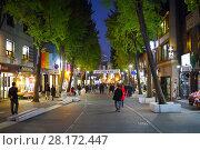 Купить «SEOUL - NOV 2, 2015: People walk on street among markets at night. South Korea has overtaken China in popularity among Russian tourists», фото № 28172447, снято 2 ноября 2015 г. (c) Losevsky Pavel / Фотобанк Лори