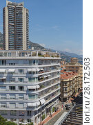 Купить «MONTE CARLO, MONACO - AUG 3, 2016: view of high rise, apartment building and street of one of densely populated districts of Monaco», фото № 28172503, снято 3 августа 2016 г. (c) Losevsky Pavel / Фотобанк Лори