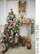 Купить «Christmas tree with garlands, vintage toys and decorative fireplace in studio», фото № 28172543, снято 16 января 2015 г. (c) Losevsky Pavel / Фотобанк Лори