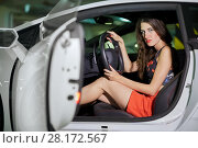 Купить «Young woman sits on driver seat in modern white car at underground parking», фото № 28172567, снято 2 июня 2016 г. (c) Losevsky Pavel / Фотобанк Лори