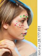 Купить «young woman with holiday makeup on her face», фото № 28177851, снято 12 декабря 2017 г. (c) Владимир Мельников / Фотобанк Лори
