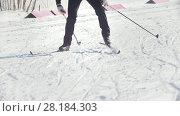 KAZAN, RUSSIA - March, 2018: slow motion of skier running by skating step on the ski track to the finish of the winter marathon. Редакционное видео, видеограф Константин Шишкин / Фотобанк Лори