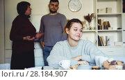 Купить «Portrait of young upset woman during quarrel with husband and his mother», видеоролик № 28184907, снято 20 декабря 2017 г. (c) Яков Филимонов / Фотобанк Лори