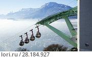 Купить «Image of aerial view of Grenoble with French Alps and cable car, France», видеоролик № 28184927, снято 21 декабря 2017 г. (c) Яков Филимонов / Фотобанк Лори