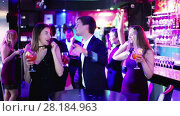 Купить «Colleagues dancing on corporate party with cocktails in hands», видеоролик № 28184963, снято 4 мая 2017 г. (c) Яков Филимонов / Фотобанк Лори