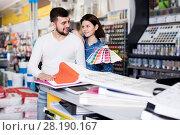 Купить «Couple examining color scheme variants», фото № 28190167, снято 9 марта 2017 г. (c) Яков Филимонов / Фотобанк Лори