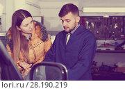 Купить «Female is dissatisfied of tire winter replacement of her car», фото № 28190219, снято 18 декабря 2017 г. (c) Яков Филимонов / Фотобанк Лори