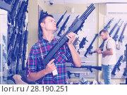 Купить «Man choice pneumatic gun», фото № 28190251, снято 4 июля 2017 г. (c) Яков Филимонов / Фотобанк Лори
