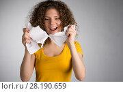 Купить «woman furiously tore the paper», фото № 28190659, снято 29 января 2018 г. (c) Типляшина Евгения / Фотобанк Лори