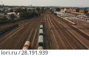 Купить «Railway yard with a lot of railway lines and freight trains. Aerial», видеоролик № 28191939, снято 22 февраля 2018 г. (c) Ярослав Ковальчук / Фотобанк Лори