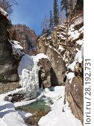 Купить «A beautiful frozen waterfall on a mountain river on a sunny March day. Mountain landscape», фото № 28192731, снято 8 марта 2018 г. (c) Виктория Катьянова / Фотобанк Лори