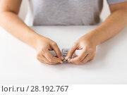 Купить «woman hands opening pack of medicine pills», фото № 28192767, снято 27 сентября 2017 г. (c) Syda Productions / Фотобанк Лори
