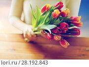 Купить «close up of woman holding tulip flowers», фото № 28192843, снято 27 января 2016 г. (c) Syda Productions / Фотобанк Лори