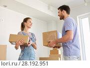 Купить «happy couple with boxes moving to new home», фото № 28192951, снято 4 июня 2017 г. (c) Syda Productions / Фотобанк Лори