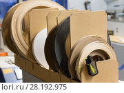 Купить «veneer or edge band tapes at woodworking factory», фото № 28192975, снято 10 ноября 2017 г. (c) Syda Productions / Фотобанк Лори