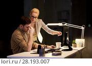 Купить «business team with computer working late at office», фото № 28193007, снято 26 ноября 2017 г. (c) Syda Productions / Фотобанк Лори