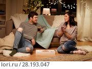 Купить «happy couple drinking coffee and eating at home», фото № 28193047, снято 13 января 2018 г. (c) Syda Productions / Фотобанк Лори