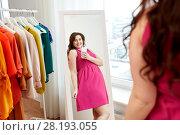Купить «plus size woman taking at mirror selfie at home», фото № 28193055, снято 21 февраля 2016 г. (c) Syda Productions / Фотобанк Лори