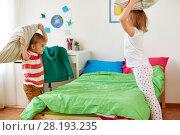 Купить «kids playing and fighting by pillows at home», фото № 28193235, снято 15 октября 2017 г. (c) Syda Productions / Фотобанк Лори