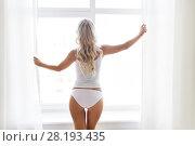 Купить «woman in underwear at window in morning», фото № 28193435, снято 20 апреля 2017 г. (c) Syda Productions / Фотобанк Лори