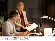 Купить «business team with papers working late at office», фото № 28193547, снято 6 декабря 2017 г. (c) Syda Productions / Фотобанк Лори