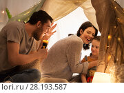 Купить «father telling scary stories to his daughter», фото № 28193587, снято 27 января 2018 г. (c) Syda Productions / Фотобанк Лори