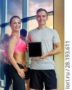 Купить «smiling young woman with personal trainer in gym», фото № 28193611, снято 29 июня 2014 г. (c) Syda Productions / Фотобанк Лори