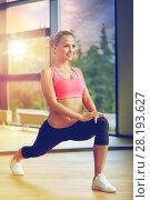 Купить «smiling woman stretching leg in gym», фото № 28193627, снято 29 июня 2014 г. (c) Syda Productions / Фотобанк Лори