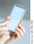 Купить «hands with social media icons on smartphone», фото № 28193743, снято 13 августа 2015 г. (c) Syda Productions / Фотобанк Лори