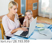 Купить «woman working from home, little daughter asking for attention», фото № 28193959, снято 23 июля 2018 г. (c) Яков Филимонов / Фотобанк Лори