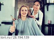 Купить «Blonde woman very much likes her fashionable hairdress in hairdressing salon», фото № 28194139, снято 7 марта 2017 г. (c) Яков Филимонов / Фотобанк Лори