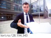 Купить «Financial director is standing upset near office», фото № 28194343, снято 3 июня 2017 г. (c) Яков Филимонов / Фотобанк Лори