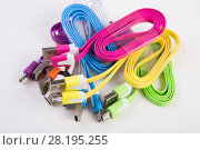 Купить «Color wires with plugs», фото № 28195255, снято 20 августа 2015 г. (c) Юрий Бизгаймер / Фотобанк Лори