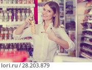 Купить «joyous girl choosing new perfume at store», фото № 28203879, снято 31 января 2018 г. (c) Яков Филимонов / Фотобанк Лори