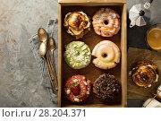 Купить «Variety of donuts in a wooden box», фото № 28204371, снято 12 марта 2018 г. (c) Елена Веселова / Фотобанк Лори