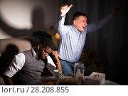 Купить «Two friends supporting different teams», фото № 28208855, снято 26 февраля 2018 г. (c) Яков Филимонов / Фотобанк Лори