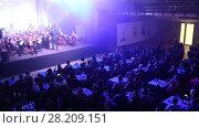 """Купить «Оркестр """"Другой Оркестр"""" играет песни """"ABBA"""". Екатеринбург», видеоролик № 28209151, снято 26 февраля 2016 г. (c) Евгений Ткачёв / Фотобанк Лори"""