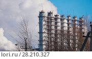 Купить «Industrial landscape, tanks of power plant», фото № 28210327, снято 20 апреля 2018 г. (c) Константин Шишкин / Фотобанк Лори