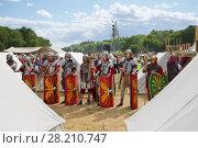 Купить «MOSCOW - JUN 06, 2015: The Roman military camp at the festival Times and epoch: Ancient Rome in Kolomenskoye», фото № 28210747, снято 6 июня 2015 г. (c) Losevsky Pavel / Фотобанк Лори