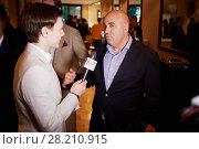 Купить «MOSCOW, RUSSIA - JUN 06, 2016: Producer Iosif Prigozhin gives an interview to a journalist at the ceremony of awarding Fashion People Awards in hotel DoubleTree by Hilton - Marina», фото № 28210915, снято 6 июня 2016 г. (c) Losevsky Pavel / Фотобанк Лори
