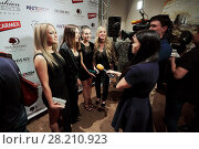 Купить «MOSCOW, RUSSIA - JUN 06, 2016: Music group Blestyashie gives interviews to journalists at the ceremony of awarding Fashion People Awards in hotel DoubleTree by Hilton Moscow - Marina», фото № 28210923, снято 6 июня 2016 г. (c) Losevsky Pavel / Фотобанк Лори