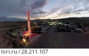 Купить «CALIFORNIA - NOV 01, 2014: Speedway near Largest Thermometer of World in Death Valley at evening. Aerial view. Thermometer is about 40 meters in height.», фото № 28211107, снято 1 ноября 2014 г. (c) Losevsky Pavel / Фотобанк Лори