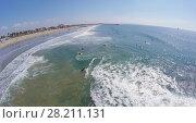 Купить «LOS ANGELES - NOV 23, 2014: Many people get fun in water in Breakwater surfing break at autumn sunny day. Aerial view. Breakwater one of the most popular surfing breaks in Venice.», фото № 28211131, снято 23 ноября 2014 г. (c) Losevsky Pavel / Фотобанк Лори