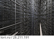 Купить «Industrial construction of many metal grey girders on modern plant», фото № 28211191, снято 16 августа 2015 г. (c) Losevsky Pavel / Фотобанк Лори