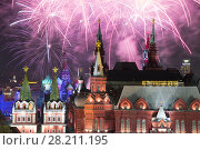 Купить «Fireworks explode over Kremlin, St. Basil Cathedral at night on Red Square in Moscow. Text on building: historic museum», фото № 28211195, снято 13 сентября 2015 г. (c) Losevsky Pavel / Фотобанк Лори